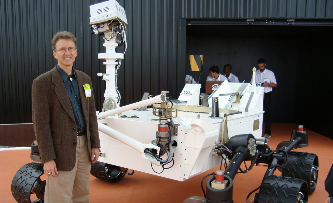 """Dr. Mars""  Roger Weins standing by the Curiosity Rover"