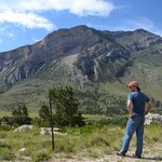 "Geology major Andrew Madsen ponders the forces that created the ""Dead Indian"" Monocline in the Rockies"
