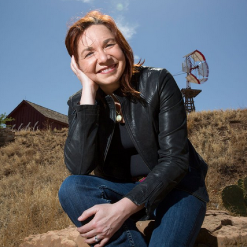 Dr. Hayhoe in the Southwestern USA, among cactus and an old-style windmill